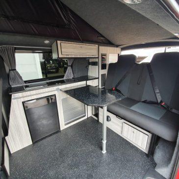 4090-vw_t6_volkswagen_transporter_camper-van_swb_ravenna_blue_stock_804